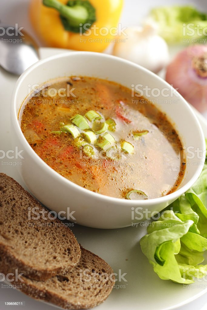 Healthy bowl of vegetable soup with a side of bread  stock photo