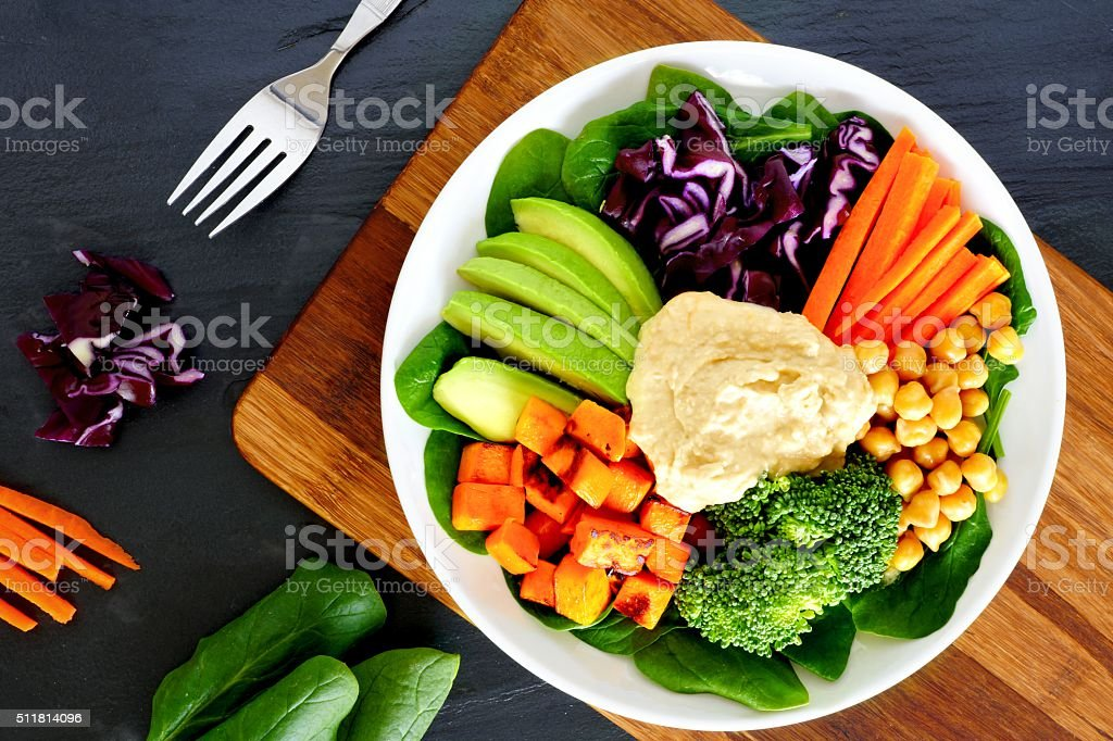 Healthy bowl with super-foods on slate background stock photo
