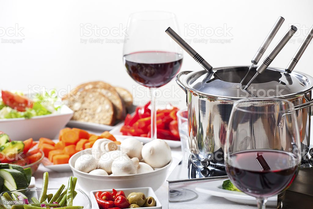 Healthy bowls of food and a fondue set stock photo