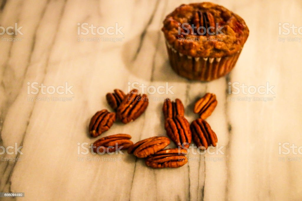 Healthy bran muffin and pecans stock photo