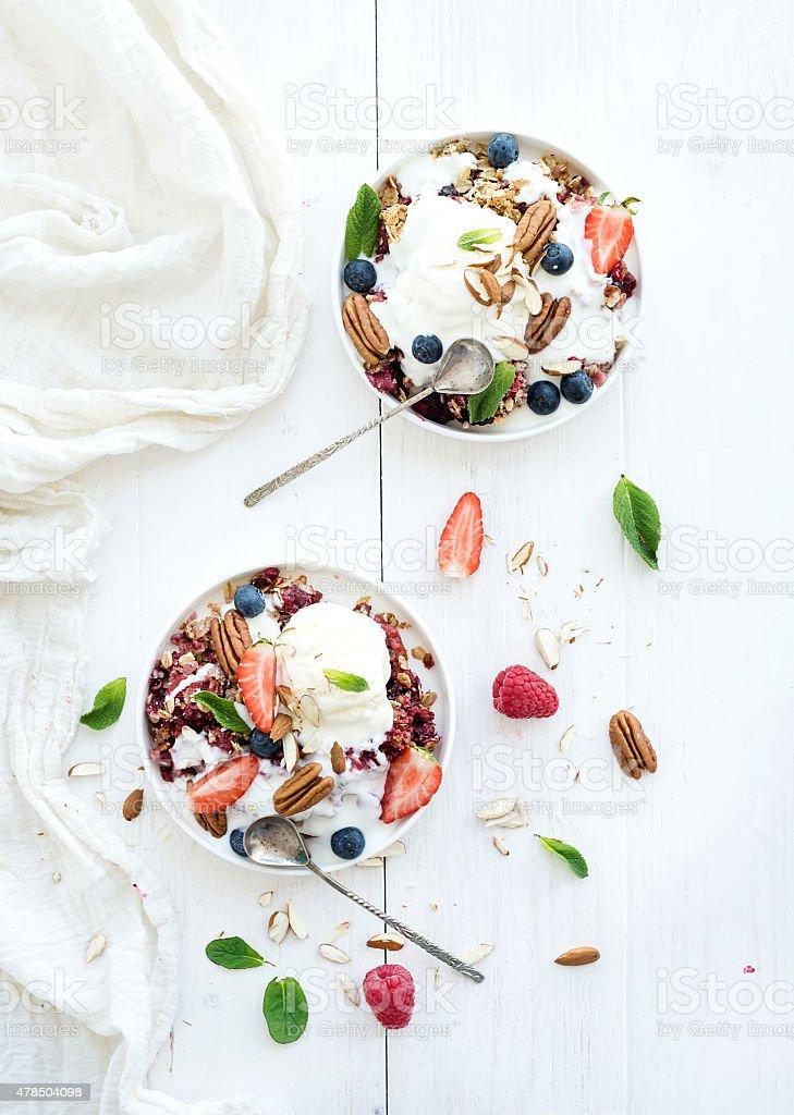 Healthy breakfast. Berry crumble with fresh blueberries, raspberries, strawberries, almond stock photo