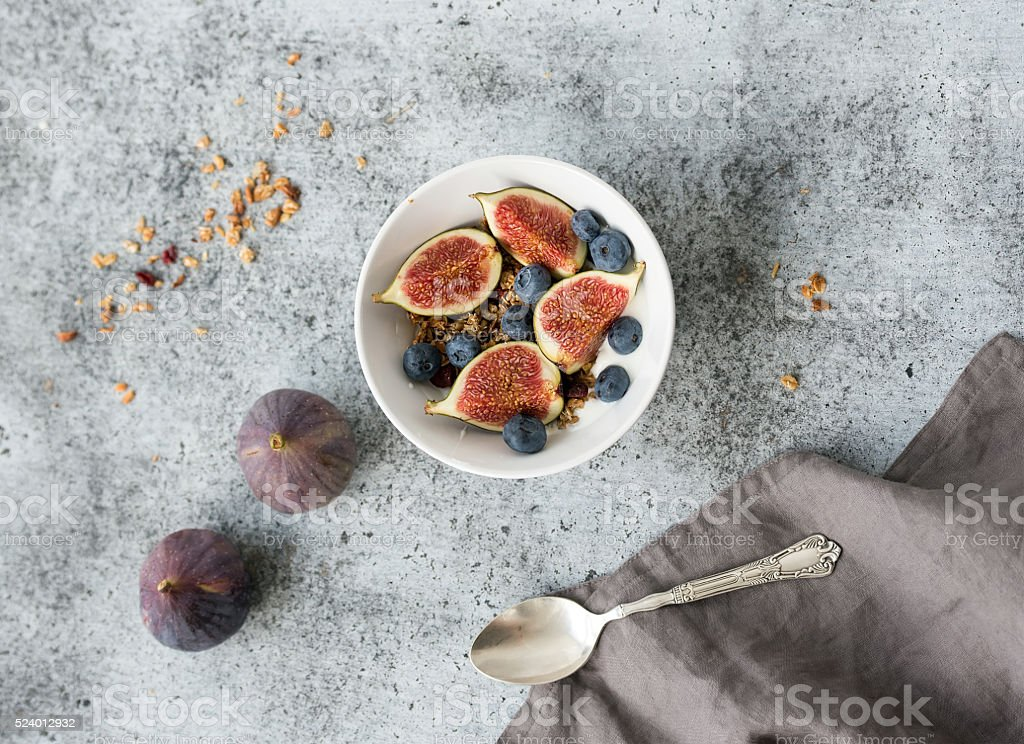 Healthy breakfast. Bowl of oat granola with yogurt, fresh blueberries stock photo