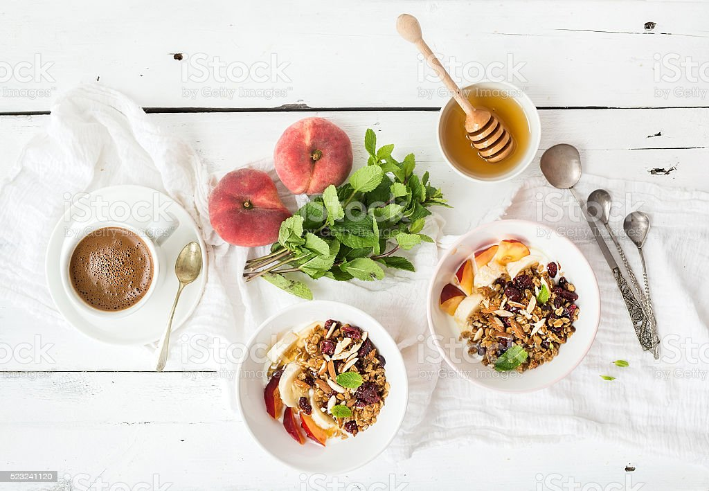 Healthy breakfast. Bowl of oat granola with yogurt, fresh fruit royalty-free stock photo