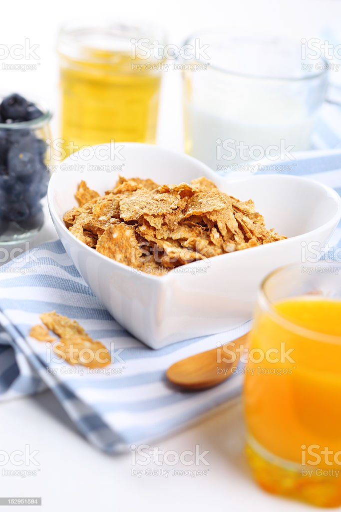 healthy breakfast- cereal with fresh blueberries, honey and milk royalty-free stock photo