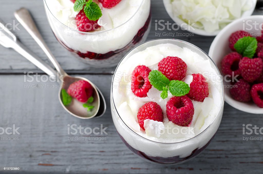 Healthy breakfast, desert, with chia seed pudding, cream, raspberry jam stock photo