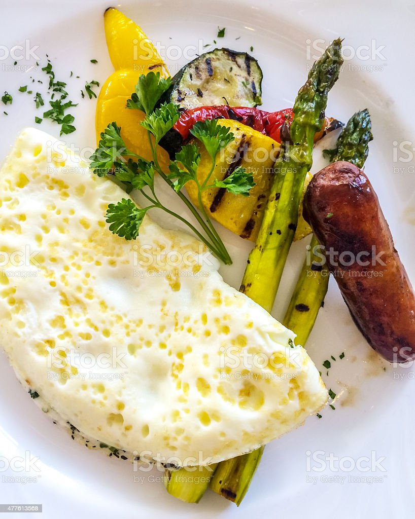 Healthy Breakfast: egg whites omelette with veggies and sausage stock photo