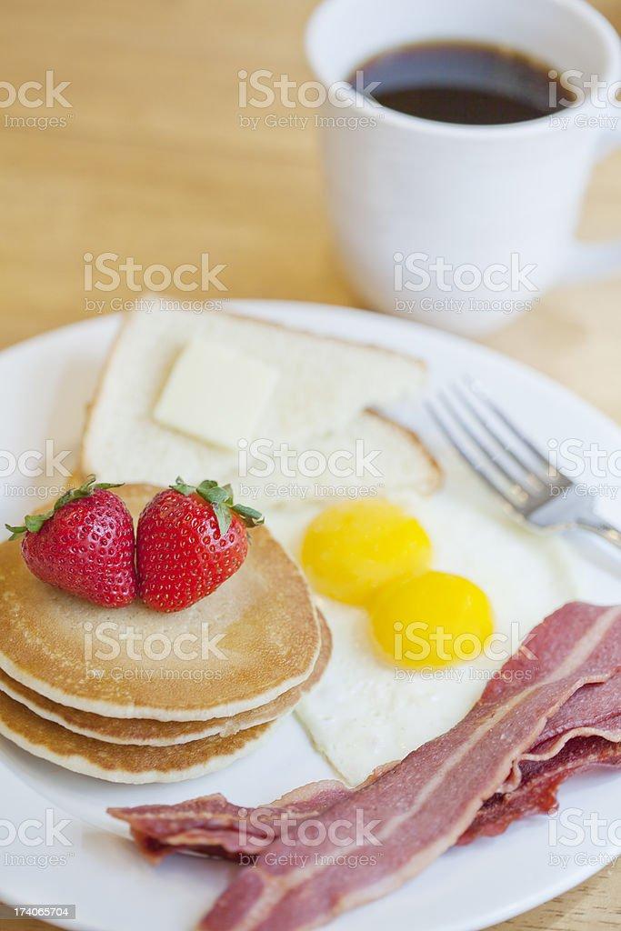 Healthy Breakfast Eggs, Coffee, Turkey Bacon, Pancakes and Toast stock photo