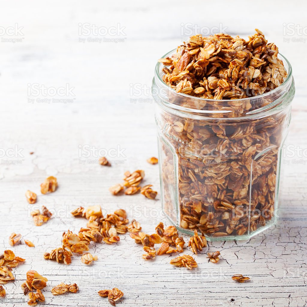 Healthy breakfast. Fresh granola, muesli in a glass jar. stock photo