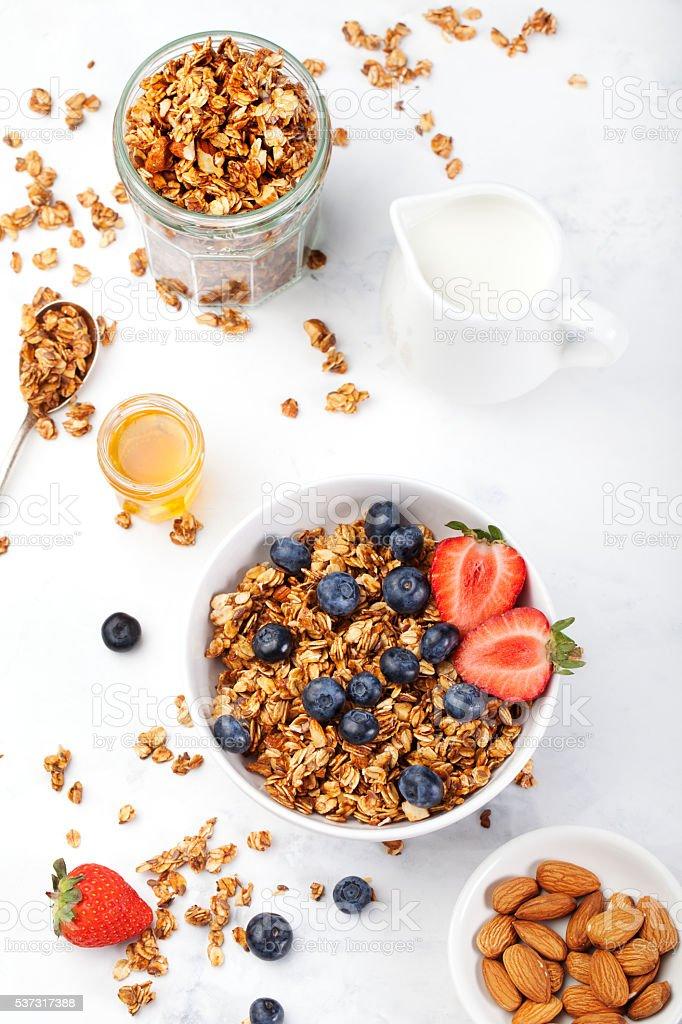 Healthy breakfast Granola, muesli in bowl with milk and berries stock photo