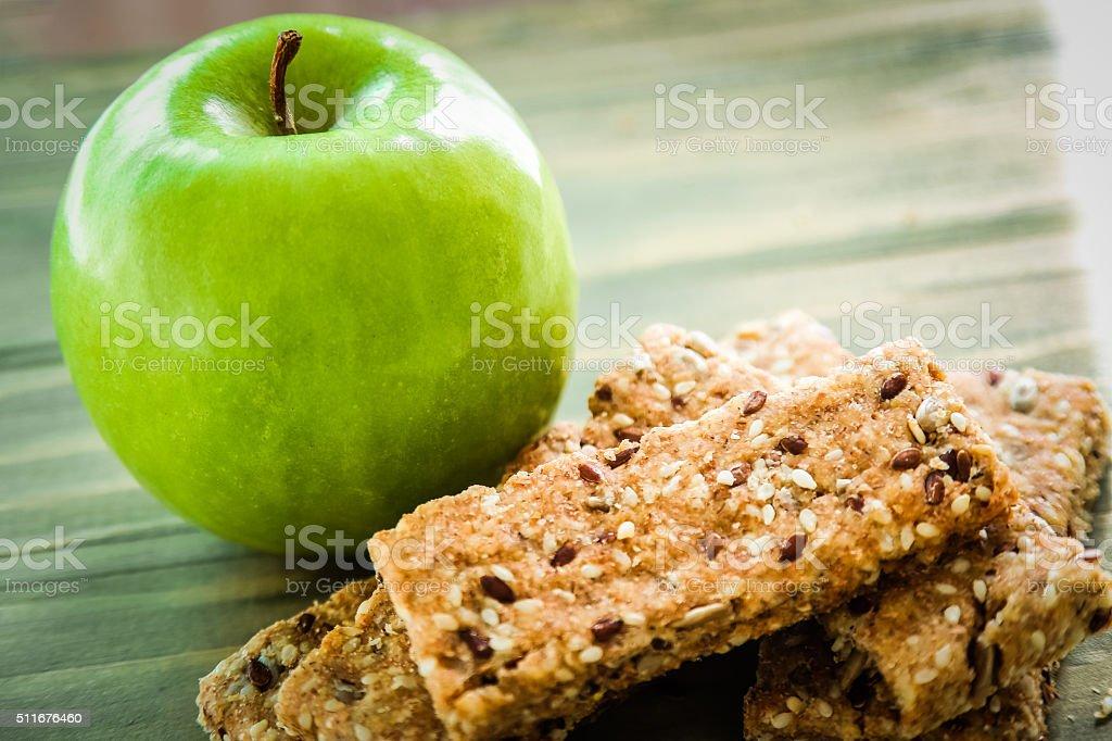 Healthy breakfast - Green Apple and Granola Bar stock photo