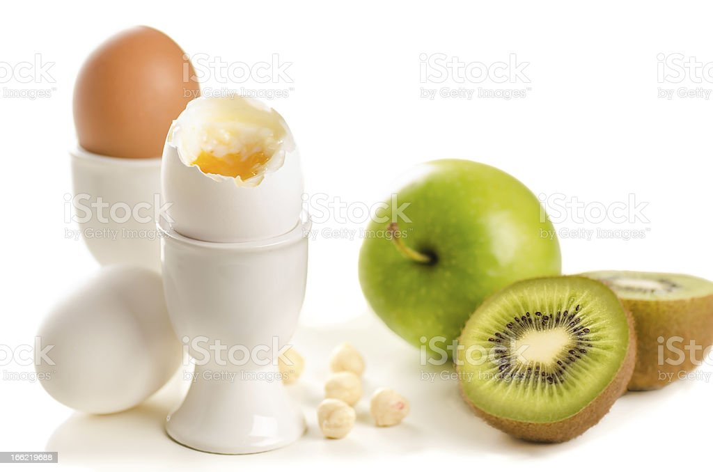 Healthy breakfast ingredients (boiled eggs, fruits and nuts) royalty-free stock photo