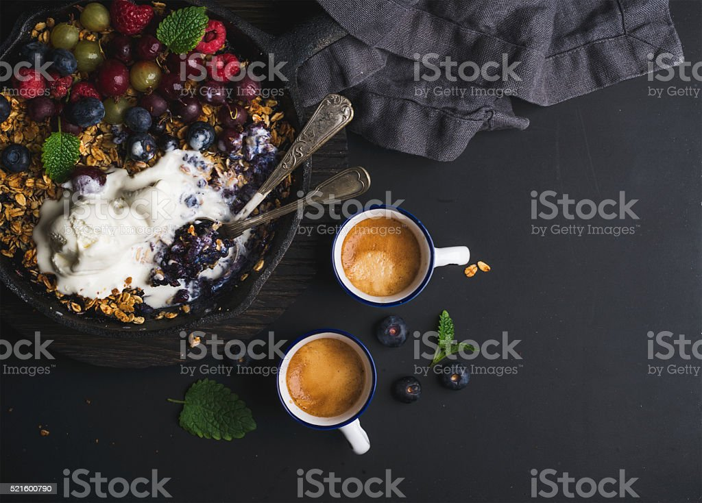 Healthy breakfast. Oat granola crumble with fresh berries, seeds and stock photo