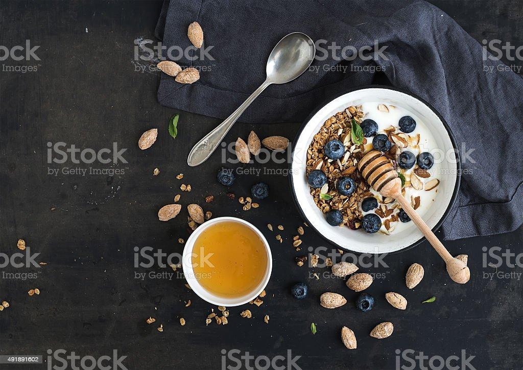 Healthy breakfast. Oat granola with fresh blueberries, almond, yogurt and stock photo