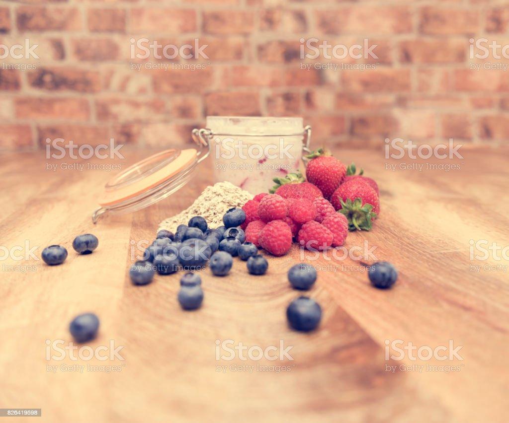 Healthy breakfast - overnight oats - fresh strawberries, raspberries and blueberries stock photo