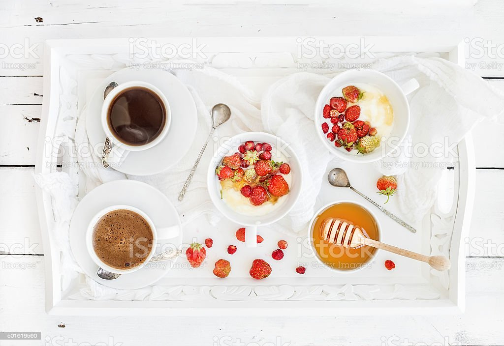 Healthy breakfast set. Yogurt, honey and wild srtawberry bowls with stock photo