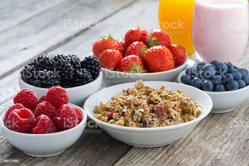 healthy breakfast with berries on wooden background, close-up stock photo