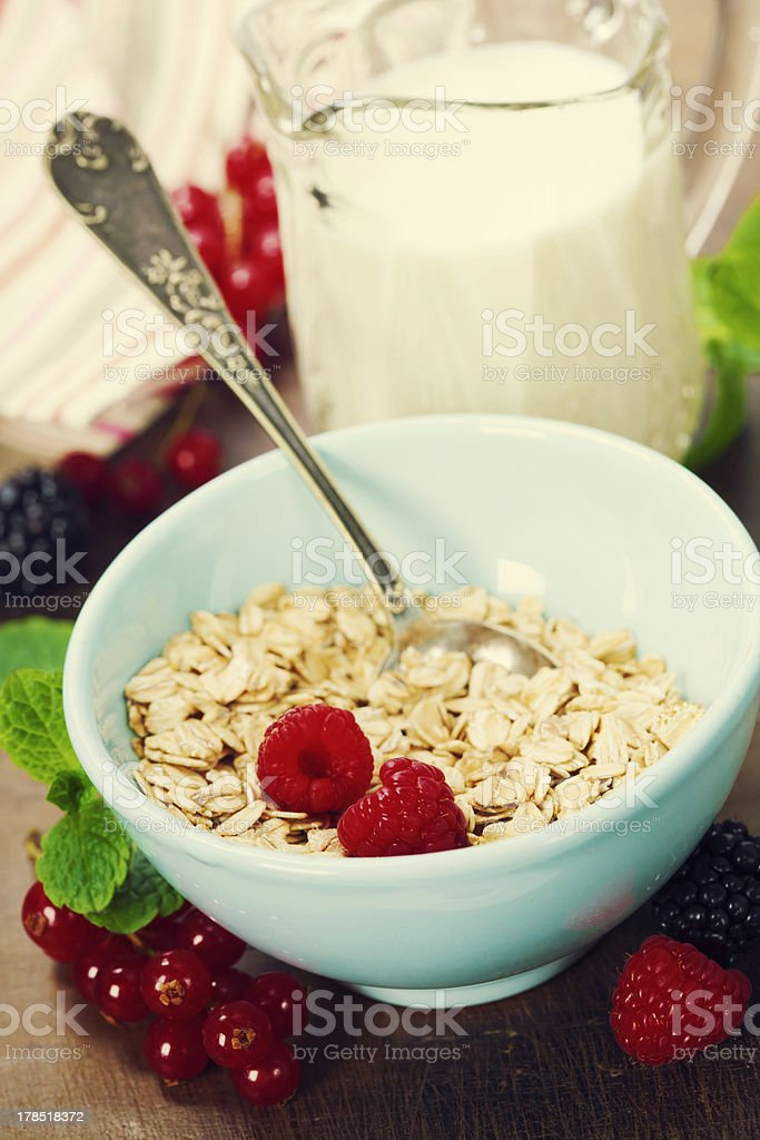 healthy breakfast with bowl of oat flakes royalty-free stock photo