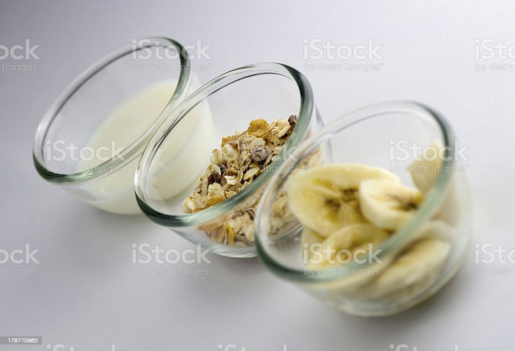 Healthy breakfast with milk, toasted muesli and banana slices royalty-free stock photo