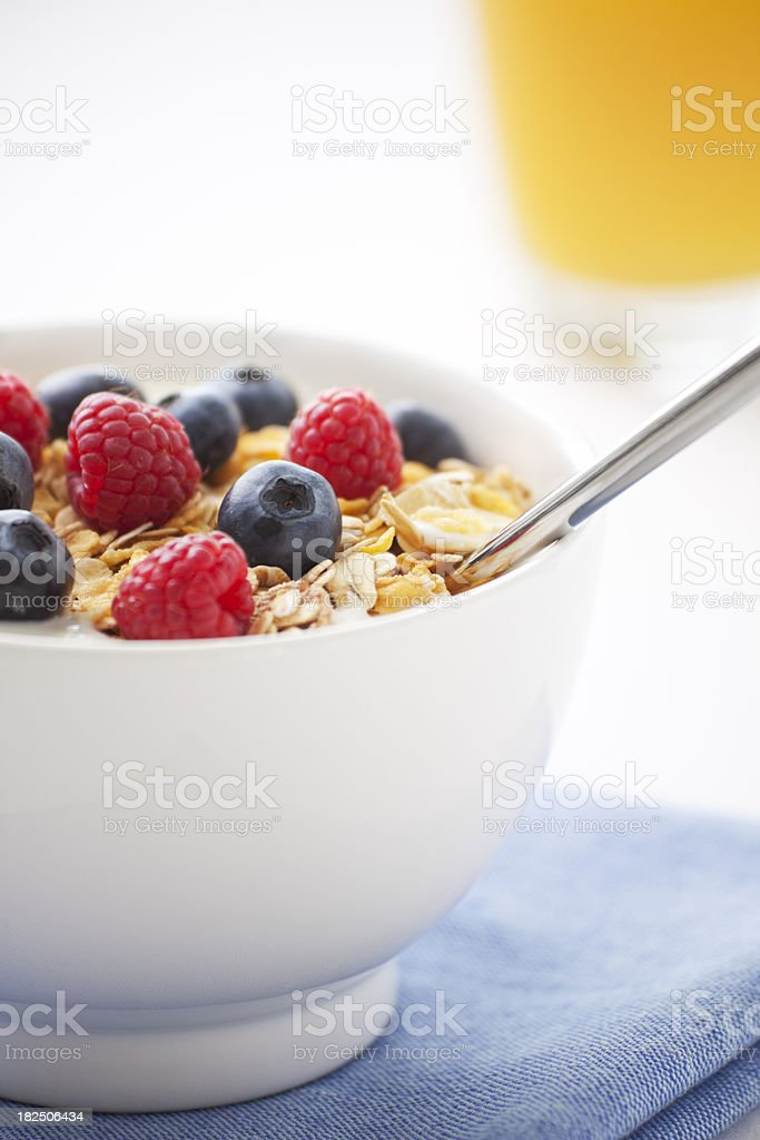 Healthy breakfast with muesli, fresh fruit and orange juice royalty-free stock photo