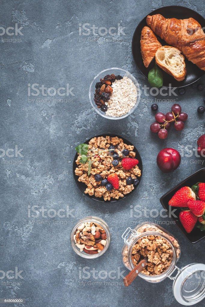 Healthy breakfast with muesli, fruits, berries, nuts stock photo