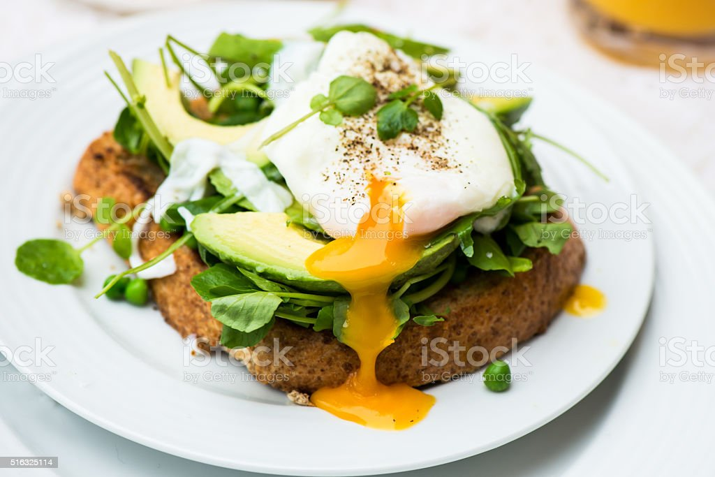 Healthy Breakfast with Wholemeal Bread Toast and Poached Egg stock photo