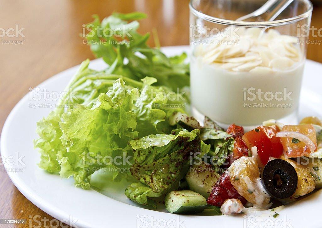 Healthy breakfast with yogurt and green salad royalty-free stock photo