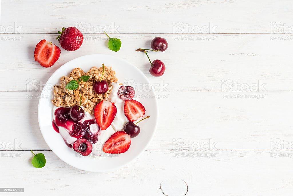 healthy breakfast with yogurt, muesli and berries stock photo