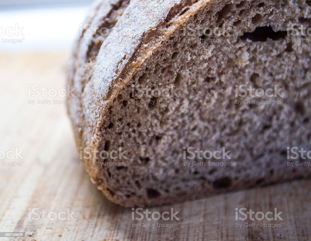 Healthy Brown Whole Wheat/Meal/Grain Bread on Breadboard royalty-free stock photo