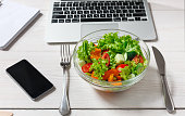 Healthy business lunch snack in office, vegetable salad bowl