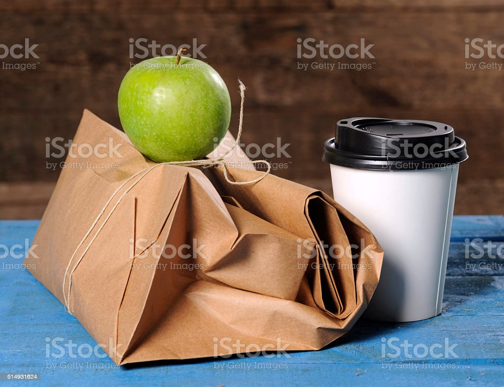 healthy business lunch with paper bag stock photo