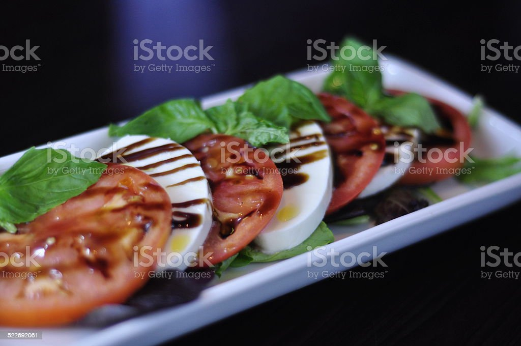 Healthy Caprese Salad with Balsamic Vinegar and Olive Oil stock photo