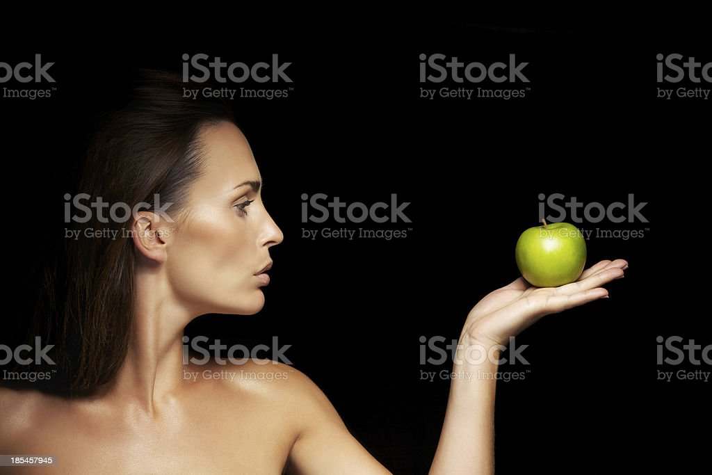 Healthy caucasian woman with apple royalty-free stock photo