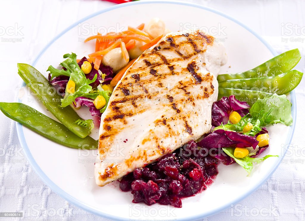 A healthy chicken and salad meal royalty-free stock photo