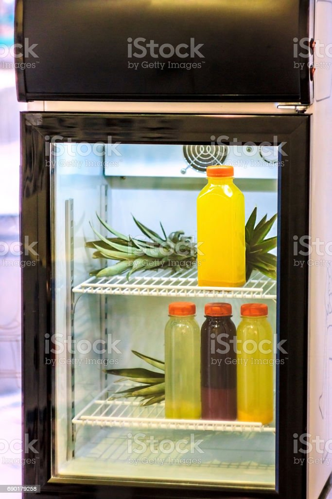 Healthy cold juices in black refrigerator stock photo