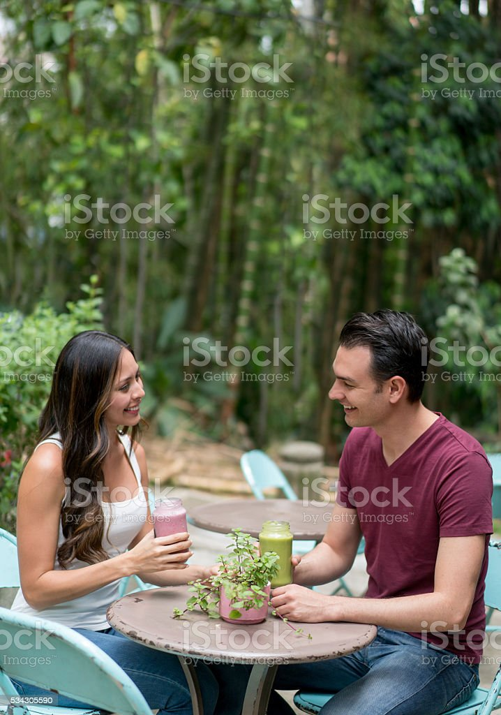 Healthy couple having a smoothie stock photo