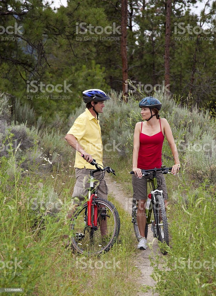 Healthy Couple on Bikes in a Forest stock photo
