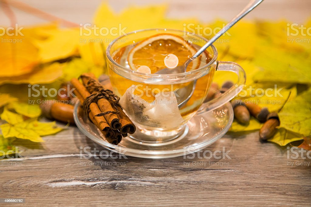 healthy cup of hot tea on wooden background, stock photo