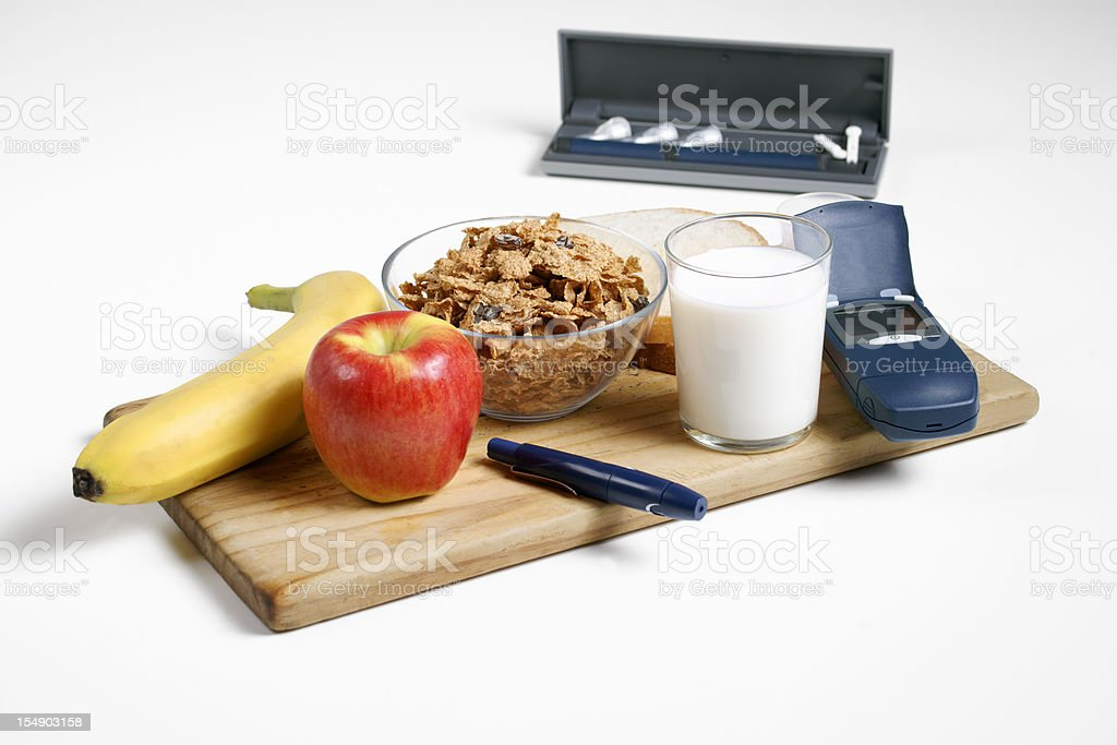 Healthy diabetic breakfast with testing and delivery devices stock photo