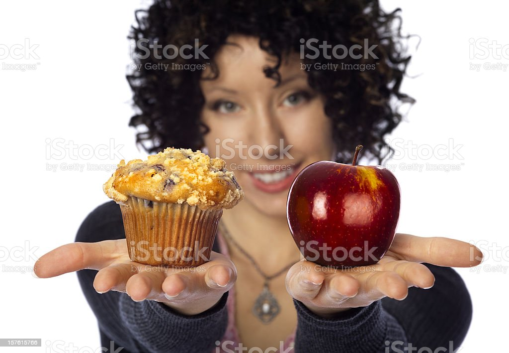 Healthy Diet Choices; Woman Holding Muffin VS Apple in Hands royalty-free stock photo