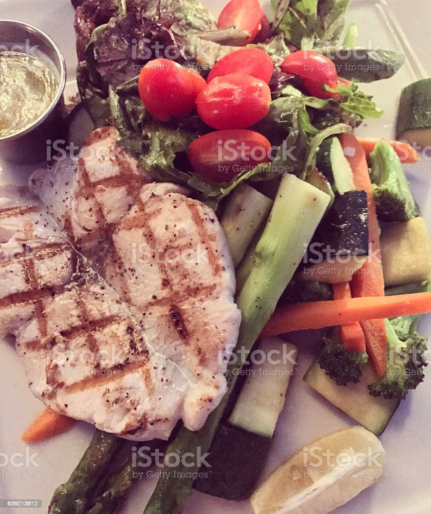 Healthy dinner: grilled wahoo fish with vegetables stock photo