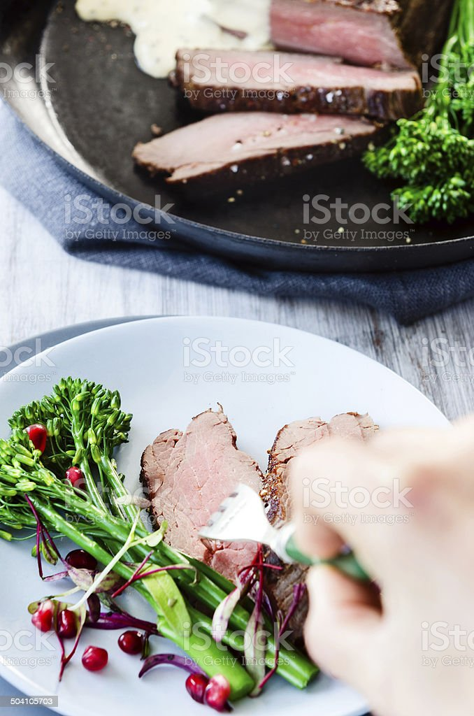 Healthy dinner lean meat slices with vegetables royalty-free stock photo