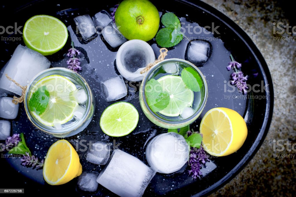 Healthy drink, mineral water with lemon and ice stock photo