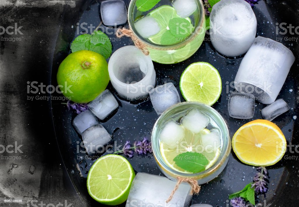 Healthy drink (juice) with lemon and ice in glass stock photo