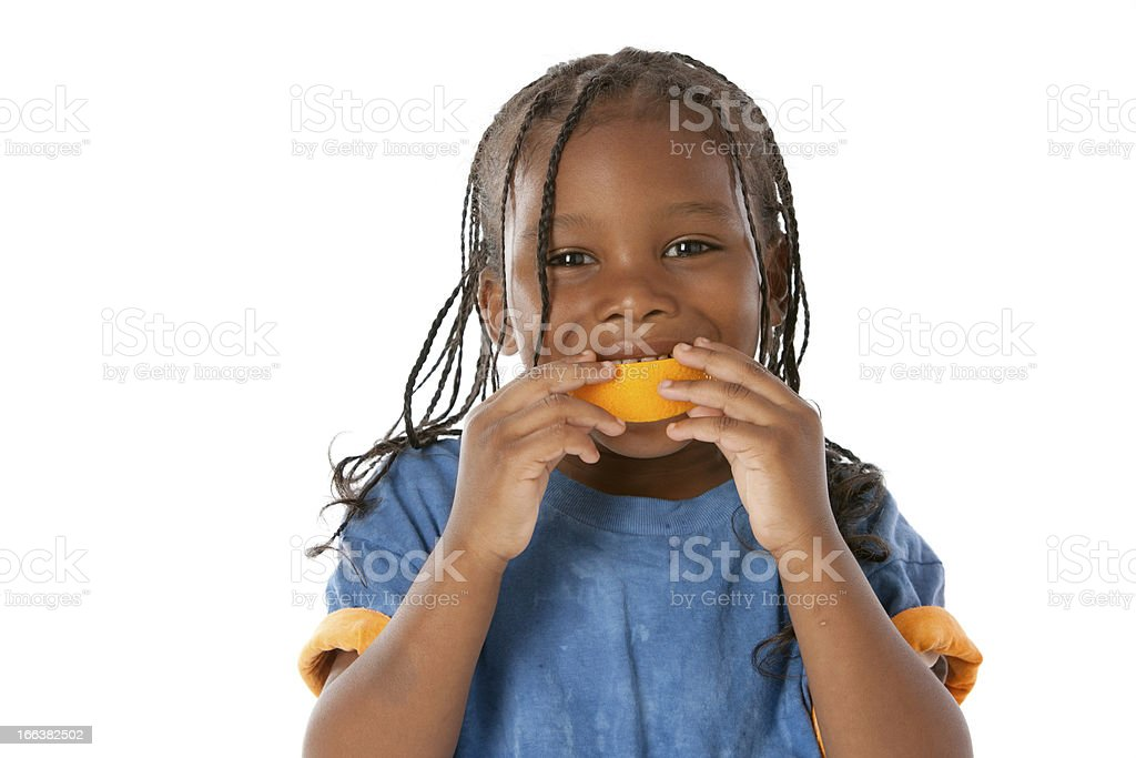 Healthy Eating: African American Little Boy Orange Mouth Fruit stock photo