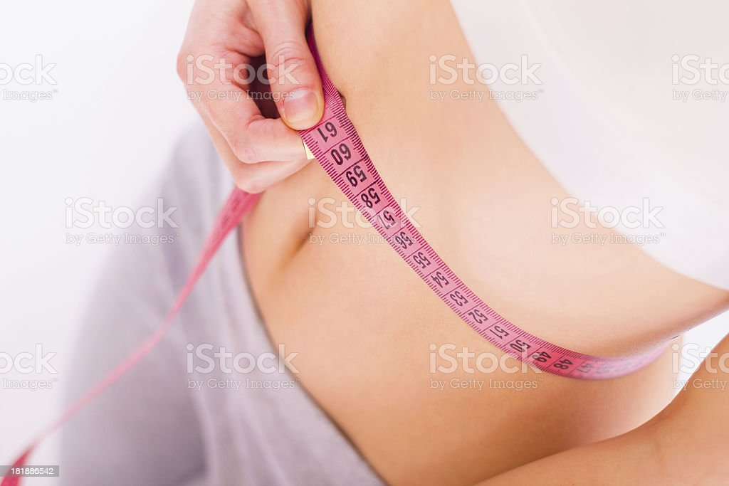 Healthy eating and exercising pays off royalty-free stock photo