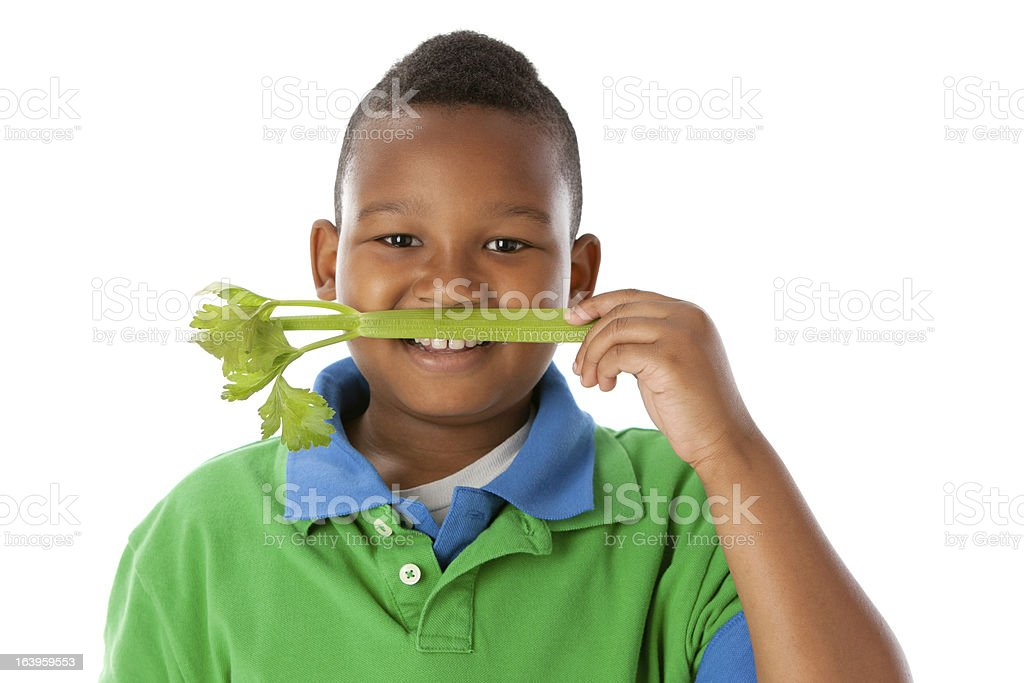 Healthy Eating: Black Little Boy Holding Celery Vegetable Head Shoulders royalty-free stock photo