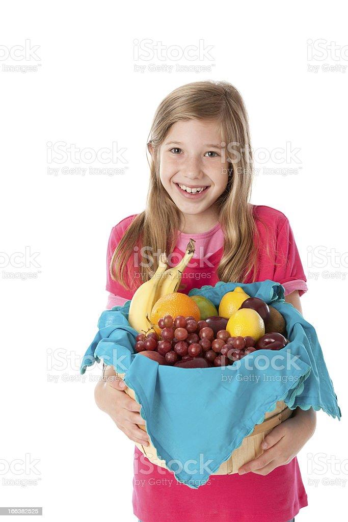 Healthy Eating: Caucasian Little Girl Holding Basket Fruit Waist Up royalty-free stock photo