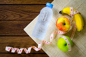 Healthy eating concept, tape measure, banana, apple, fruit and w