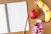 Healthy eating concept, tape measure, fruit and water bottle on