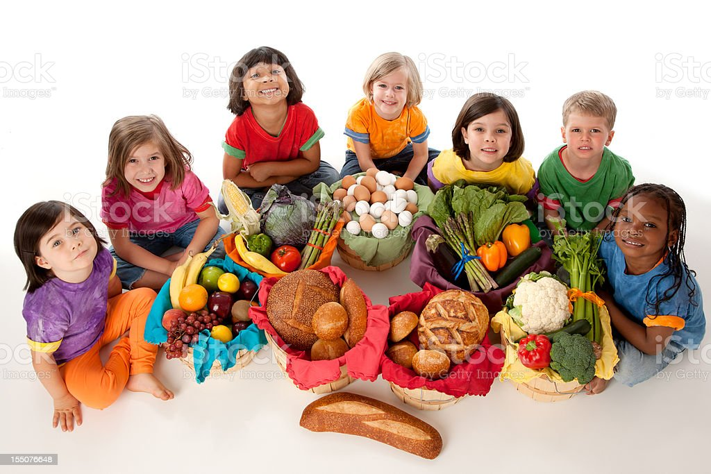 Healthy Eating: Diverse Group Children Food Baskets High Angle royalty-free stock photo